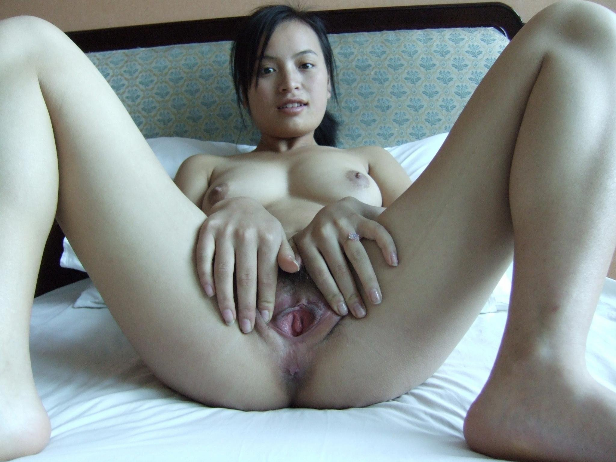 Indonesian asian girl with bald pussy plays with red dildo